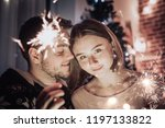young couple celebrating... | Shutterstock . vector #1197133822