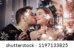 young couple celebrating... | Shutterstock . vector #1197133825