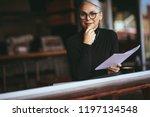businesswoman sitting at a... | Shutterstock . vector #1197134548
