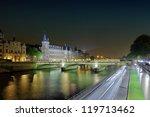 Castle Conciergerie and bridge of Change. - stock photo