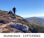 a couple of mountaineers at the ... | Shutterstock . vector #1197143062