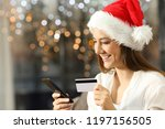 girl paying on line with credit ... | Shutterstock . vector #1197156505