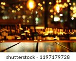 top of wood table with blur... | Shutterstock . vector #1197179728