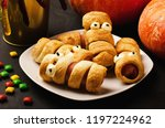 scary sausage mummies in dough... | Shutterstock . vector #1197224962