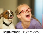 Stock photo beautiful girl with a down syndrome with her pet jack russell terrier 1197242992