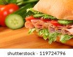 fresh ham sandwich on wooden... | Shutterstock . vector #119724796