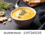 pumpkin cream soup in bowl on... | Shutterstock . vector #1197265135