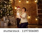 mother or grandmother with her...   Shutterstock . vector #1197306085
