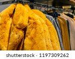 yellow winter fur jackets on... | Shutterstock . vector #1197309262