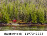 red cabin on edge of alaskan... | Shutterstock . vector #1197341335
