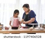 asian girl looking her mother... | Shutterstock . vector #1197406528