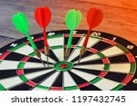 Stock photo red and green dartboard winner success for investment right on target concept using dart in the 1197432745