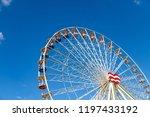 ferris wheel on a fairground in ...   Shutterstock . vector #1197433192