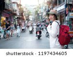 young traveler with backpack at ... | Shutterstock . vector #1197434605