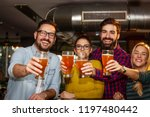four friends toasting with full ... | Shutterstock . vector #1197480442