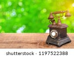 retro telephone on wooden with... | Shutterstock . vector #1197522388