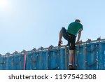 athlete climbing over a...   Shutterstock . vector #1197542308