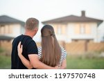 couple looking at they's house | Shutterstock . vector #1197570748