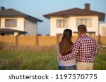 couple looking at their house | Shutterstock . vector #1197570775