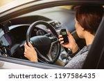 young millennial woman using... | Shutterstock . vector #1197586435