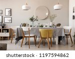 wooden chairs at table with... | Shutterstock . vector #1197594862