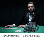 player at the poker table. | Shutterstock . vector #1197665188