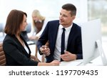 employees discussing business... | Shutterstock . vector #1197709435