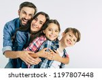 power in big family. dad and... | Shutterstock . vector #1197807448