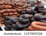 sausage on a market stand. | Shutterstock . vector #1197895528