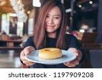 a beautiful asian woman holding ... | Shutterstock . vector #1197909208