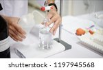 scientists are experimenting... | Shutterstock . vector #1197945568