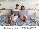 young attractive couple sitting ... | Shutterstock . vector #1197949252