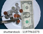 One Dollar Lying On The Plate...