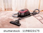 vacuum cleaner in the room on... | Shutterstock . vector #1198023175