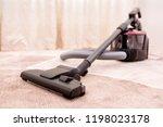 vacuum cleaner in the room on... | Shutterstock . vector #1198023178