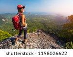 woman hiker stands on top of... | Shutterstock . vector #1198026622