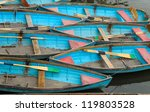 Colourful Rowing Boats Tidily...