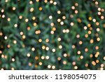 blurred golden garland on... | Shutterstock . vector #1198054075