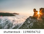 man relaxing alone on the edge... | Shutterstock . vector #1198056712
