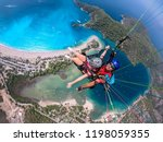 paragliding in the sky.... | Shutterstock . vector #1198059355