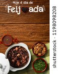 """Small photo of Brazilian Feijoada Food. Written """"Today is Feijoada's Day"""" in Portuguese. Top view with copy space."""
