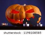 halloween pumpkin. candles  bat ... | Shutterstock . vector #1198108585