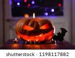 halloween pumpkin. candles  bat ... | Shutterstock . vector #1198117882