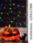 halloween pumpkin. candles  bat ... | Shutterstock . vector #1198117888