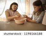 children in real kitchen make... | Shutterstock . vector #1198166188