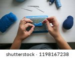 the hands craftsman with the... | Shutterstock . vector #1198167238