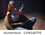 sexy girl with smartphone and...   Shutterstock . vector #1198168795