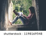 kid girl on the box with the... | Shutterstock . vector #1198169548