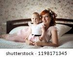 gentle mother and daughter on... | Shutterstock . vector #1198171345