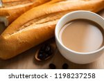 cup of coffee and baguette... | Shutterstock . vector #1198237258